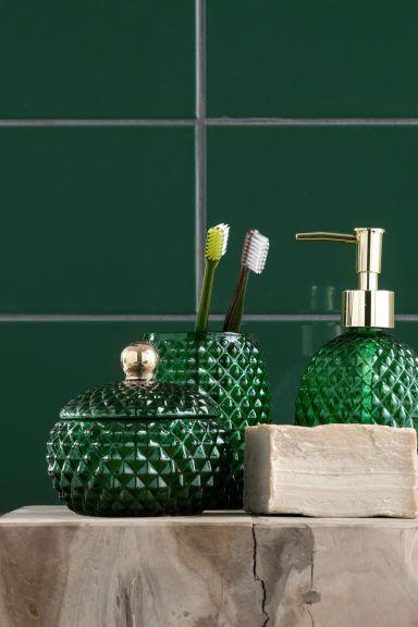 Portaspazzolino in vetro: Portaspazzolino in vetro dai motivi strutturati. Misure circa 8x10,5 cm.