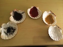 Make your own pigment in scallop shells (you can get scallops in half shells from the supermarket - very tasty). Grind down dried clay, chalks and pastels and experiment with binding agents e.g. water, glue, oil. I found suet works well - and you can get vegetable suet so no need for animal products.