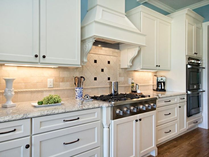 White Kitchen Exhaust Hoods blue and white kitchen | black tiles, white cabinets and