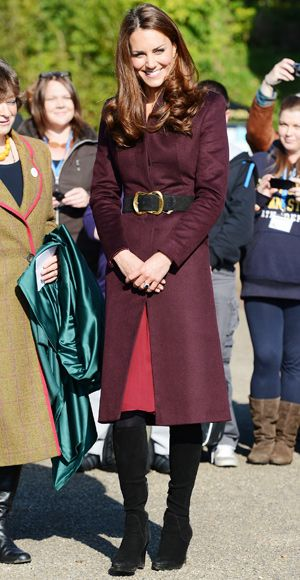 Kate wrapped up in an aubergine coat by an unnamed independent British designer, a look she first wore Christmas Day 2011 for the royal services.