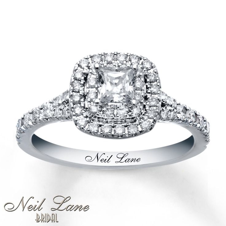 A princess-cut diamond steals the show at the center of this thrilling engagement ring for her from the Neil Lane Bridal® collection. Two rows of additional round diamonds frame the center, with more round diamonds sparkling along the band. The ring is styled in 14K white gold and has a total diamond weight of 1 carat. Diamond Total Carat Weight may range from .95 - 1.11 carats.