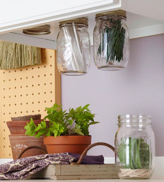 Organize items in clear canning jars. More DIY storage: http://www.bhg.com/decorating/do-it-yourself/accents/diy-storage-for-every-room/#page=7: Spices Storage, Workshop Storage, Canning Jars, Cabinets Storage, Storage Jars, Mason Jars, Storage Ideas, Kitchens Storage, Jars Lids