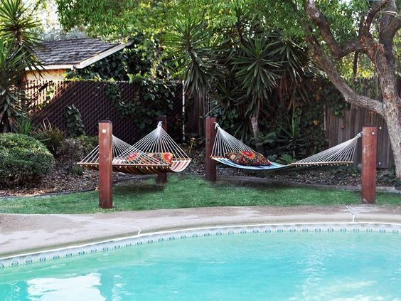 10 DIY Hammock Stand Ideas That You Can Make This Weekend - Craft Directory - Section off a corner of the yard with mulch or sand and set the hammock in that area with a table and chair to avoid mowing under it.