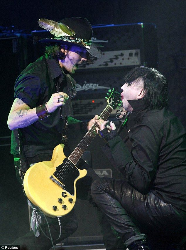 Johnny Depp plays lead guitar and rocks out on stage with Marilyn Manson at the Golden Gods Awards    Read more: http://www.dailymail.co.uk/tvshowbiz/article-2128755/Johnny-Depp-plays-lead-guitar-rocks-stage-Marilyn-Manson-Golden-Gods-Awards.html#ixzz1rsReI0PY