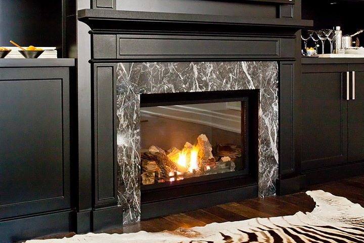 A gas fireplace has become an popular choice in custom entertainment units.