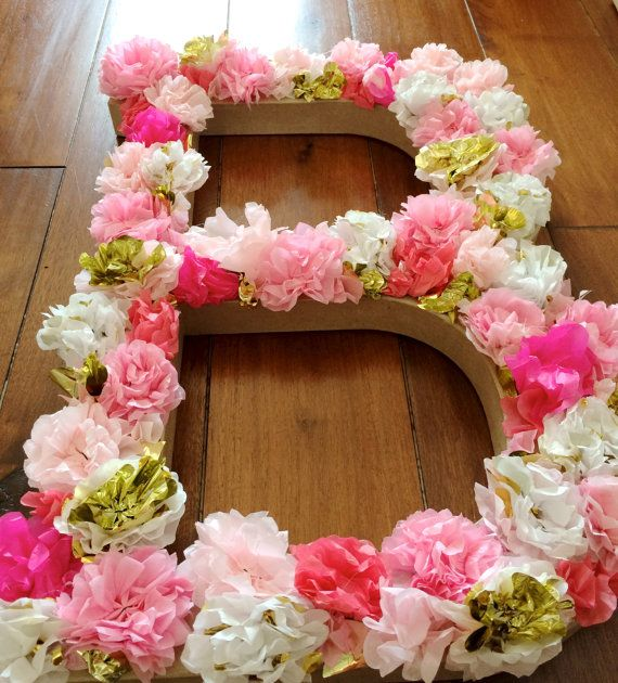 Would be easy to diy. Hot glue tissue paper flowers to a large letter either from the craft store or made out of cardboard