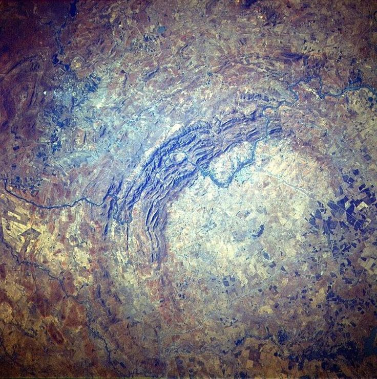 NASA's photo of the Vredefort Dome in South Africa, the largest verified impact crater on earth. The asteroid that caused it 2.023 billion years ago is thought to have been approximately 5-10 km (3.1-6.2 mi) in diameter.