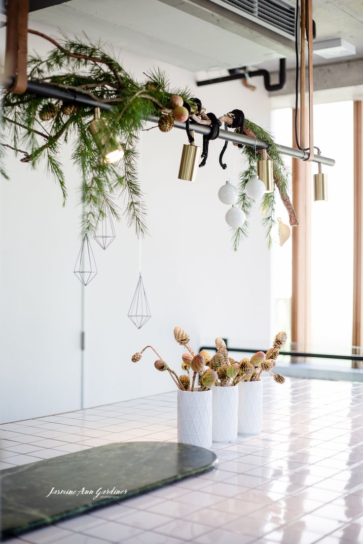 DY.o events (aka Duo) Soft and subtle Christmas hanging installation with gold sprayed leucadendron nuts. Interior styling.