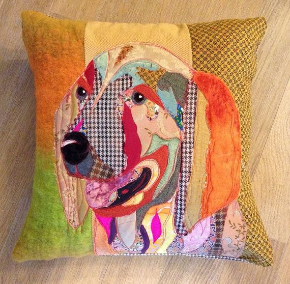 An appliqued cushion, built up from a variety of vintage, antique, and new fabrics, this creates a very sumptious and rich feel. I use the