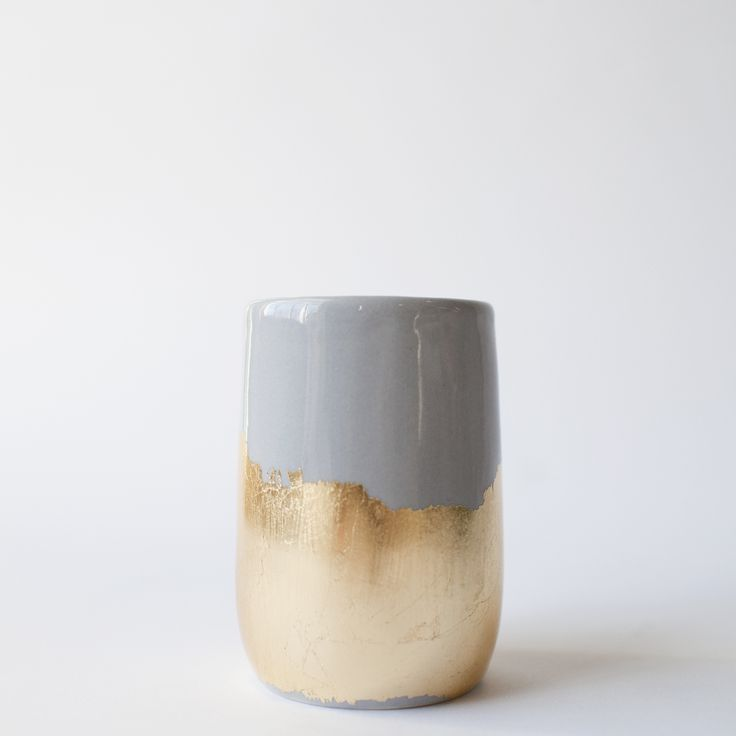 Of all the color combos that we have seen come out of Emily Reinhard's studio, this is our favorite. The soft, quiet grey has purple overtones that look unbelievable with the gold brush strokes. Use this 4.5 inch tall vessel as a vase or to hold your makeup brushes.Not food safe, handle and wash with care.Artist: The Object Enthusiast
