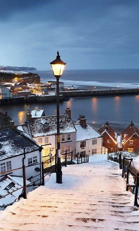 Whitby covered by snow, North Yorkshire, England, ive lost count of the times ive been here and i will never get bored. You are asking for trouble doing the steps when icy :)