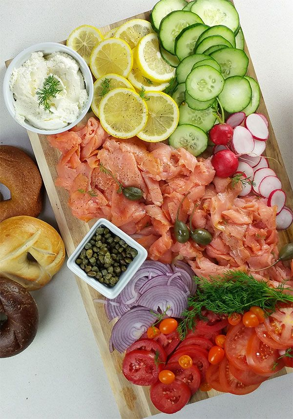 SMOKED SALMON & BAGEL BAR--assemble a bunch of bright colors around the salmon and let everyone pick and choose their own combinations.