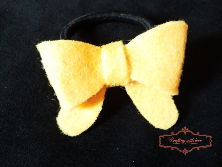 Handmade felt bow ponytail holder.