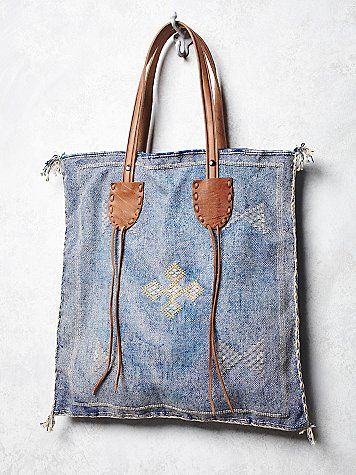 Granada Tote | The details on this boho inspired square fabric tote are enchanting, especially the beautiful leather handles and embroidery design.  Inside is lined with a top zipper closure.      *By Z & L