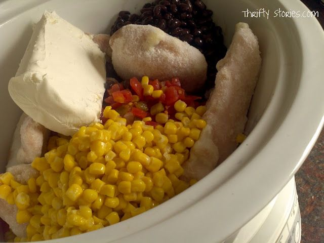 1 (2.5 – 3 lb) bag frozen chicken (recipe called for tenderloins, I used breasts -worked fine) 1 block cream cheese 1 (15 oz.) can of corn (drained) 1 (15 oz.) can of black beans (rinsed and drained) 1 (10 oz.) can of rotel tomatoes (generic is also fine)