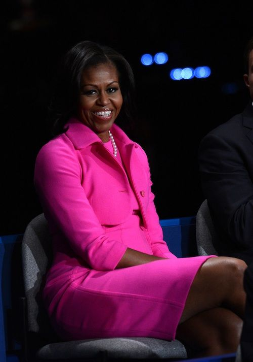 Michelle Obama wears a Michael Kors jacket and dress for the 2nd Presidental Debate in 2012
