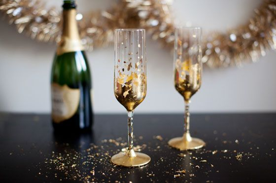 New Years Eve is approaching and I have champagne on the mind. I took a look at a set of plain, cheap champagne flutes that I bought, and got inspired to jazz them up a bit. I wanted something glam...