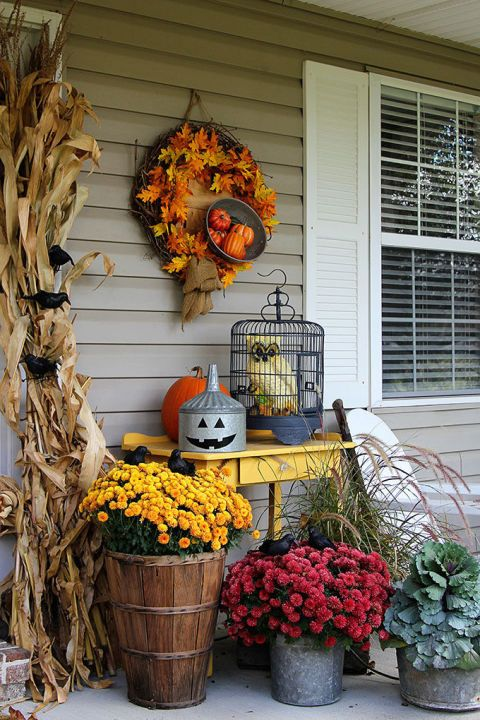 Blogger Pam of House of Hawthornes doesn't like to completely redecorate her porch for Halloween. Instead, she updates her fall decor with a few more festive finds like jack-'o-lanterns and crows come October. She suggests starting your hunt at the dollar store to keep things budget-friendly.   See more at House of Hawthornes.