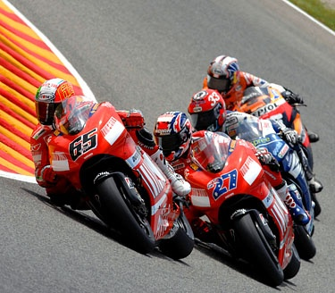 Stoner and Capirossi taming the Ducati.   Stoner wins the title.