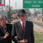 Donald and Louise Hollowell stand next to the Donald L. Hollowell Parkway in Atlanta. The former Bankhead Highway was renamed in 1998 in honor of the prominent civil rights attorney.