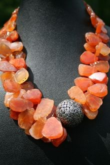 Carnelian rough matte flat nuggets with ornate focal bead - if you must use nuggets this rough, that's how to use them! The highly structured focal organizes and tames the wild chunks.