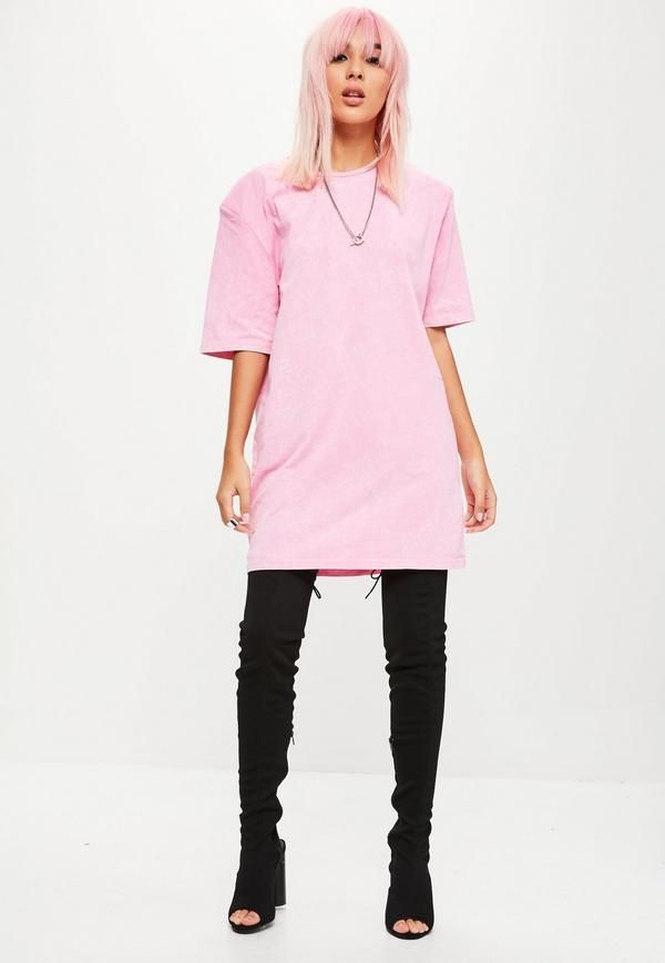 Pink t shirt dress featuring an acid wash, shoulder pads, short sleeves and round neckline.