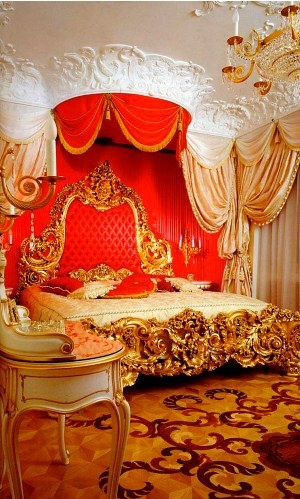 This bed is adorable! LOVE how its a mini canopy on the ceiling over the bed and LOVE the bright red combining with gold.