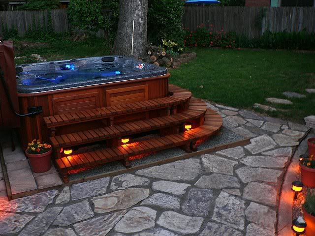 Hot Tub Ideas Backyard wooden hot tub that connects two lawn levels and looks like it is built in Find This Pin And More On Backyard Oasis Hot Tub
