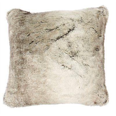 """Escape the everyday with a luxurious faux fur pillow cover that transforms any sofa or bed into a sumptuous retreat. Its long-haired pile beckons with an ultra-soft hand and rich tonal sheen that mimics the real thing. A concealed zipper ensures easy care. Insert not included. 18"""" x 18"""". Front: 80% acrylic, 20% polyester. Back: 100% polyester. Machine-wash cold. Line dry. Do not iron. Available only at Indigo."""