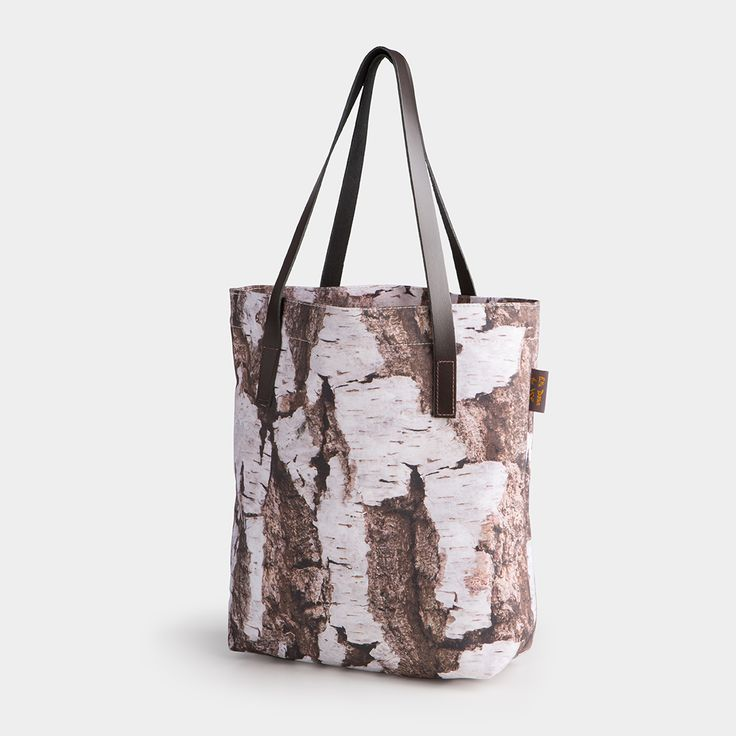 Stylish tote from Ella Doran's 'Through the Camera Lens' design, inspired by the woodland at YSP. Featuring leather handles and an internal zipped pocket.
