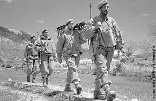 A band of Greek army commandos on the move during the Greek Civil War. (Photo by Bert Hardy/Picture Post/Getty Images). 1948