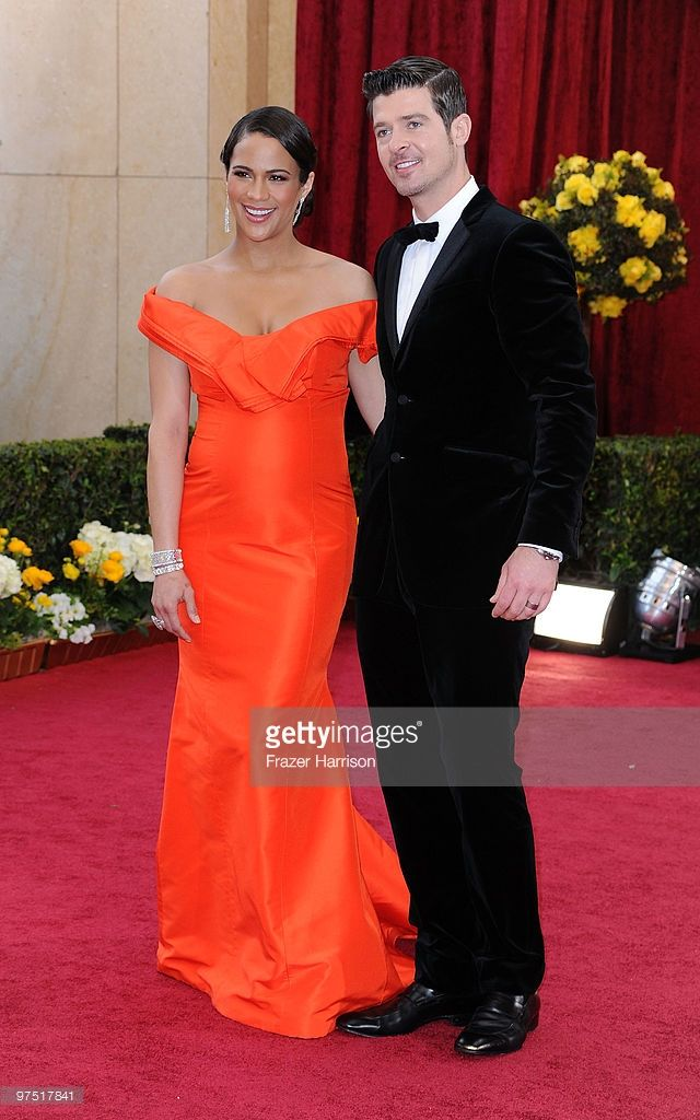 Actress Paula Patton arrives with her husband singer Robin Thicke at the 82nd Annual Academy Awards held at Kodak Theatre on March 7, 2010 in Hollywood, California.
