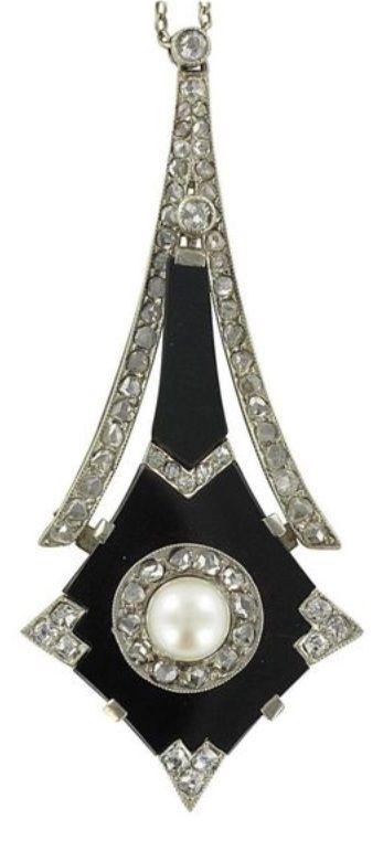 An Art Deco platinum, onyx, diamond and pearl pendant, French, circa 1930. 5.5 x 2.5cm. #ArtDeco