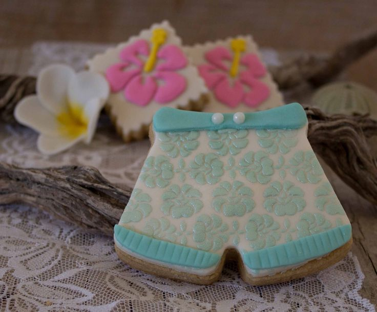 Sugar cookies: board shorts with tropical hibiscus flower cookies