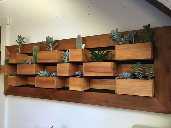 This 60 succulent wall planter is made from California Redwood and will hole 18…