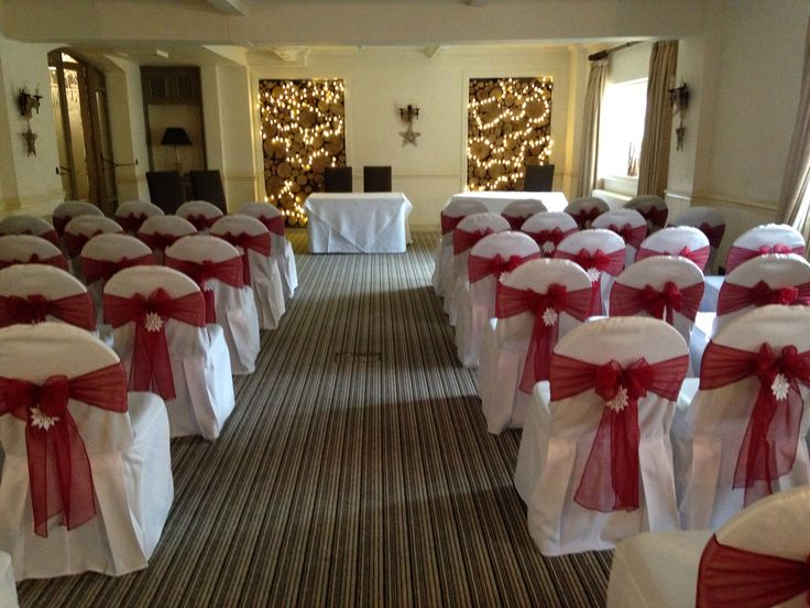 Chair covers with wine sashes and snowflakes