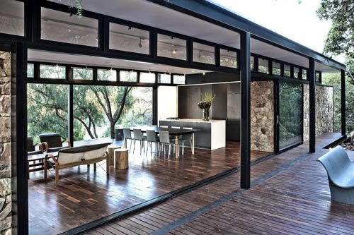 Nestled into the edge of a cliff in a suburb of Johannesburg, South Africa, the Westcliff Pavilion residence is built from steel, glass and stone and appears to hover above the ground. Designed by GASS Architecture Studio to make the most of the city views, the steel framed house comes complete with one side that's mostly glass and a floating stone wall.