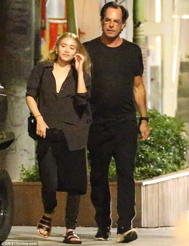 What a gent:Ashley Olsen's much older financier lover Richard Sachs escorted her to his car  in St Barts on Monday