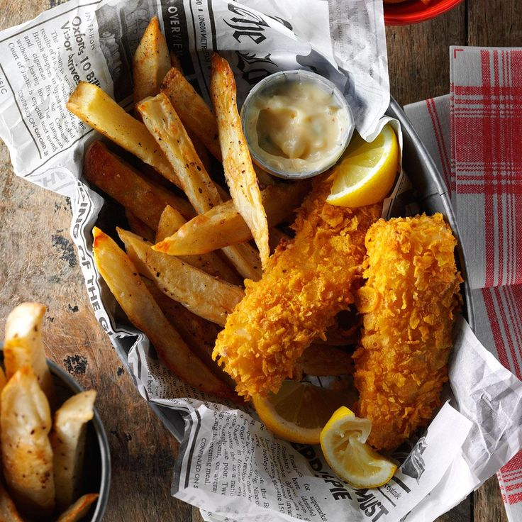 Fish and Fries Recipe -For an awesome crunch and golden color without deep frying, we coat fish with cornflake crumbs and bake it. Try it with homemade french fries for a fun spin on fish and chips. —Janice Mitchell, Aurora, Colorado