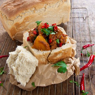 Lamb Bunny Chow, a South African Indian specialty.  We used to eat these at the beach or after a good party!  Yum!