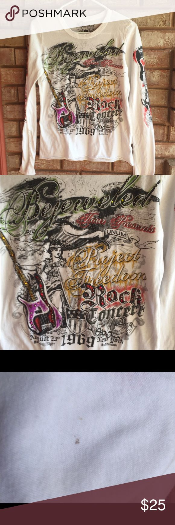 "Bejeweled Tee Awesome shirt, Bejeweled by Susan Fixel. No missing rhinestones. Only small stain (dots) under the ""s"" in Rocks on the sleeve. Great shirt to wear to your next rock concert! Bejeweled by Susan Fixel Tops Tees - Long Sleeve"