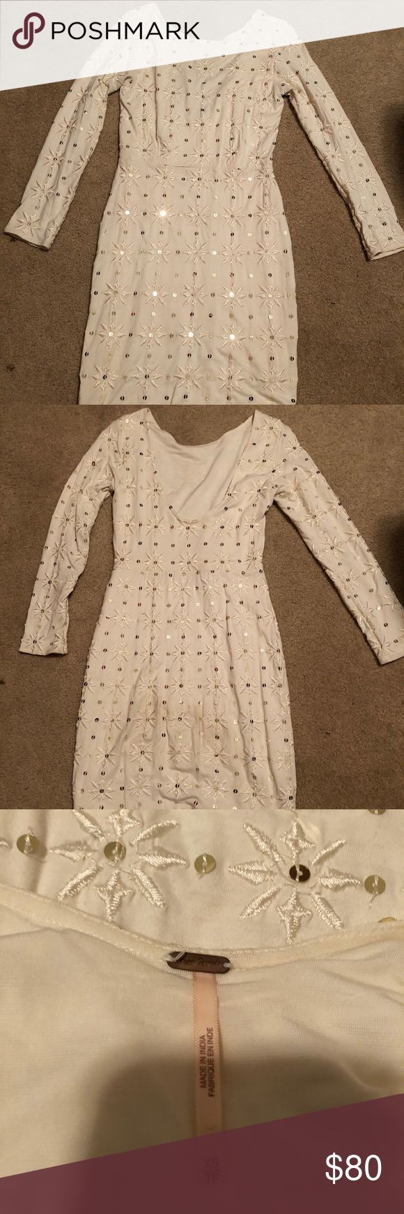 Free People Sparkle Dress White snowflake like sparkle design. Perfect for winter occasions like New Years Eve or Christmas parties. Hugs body with low cut back. Falls couple inches above knee on 5' female. Free People Dresses Long Sleeve