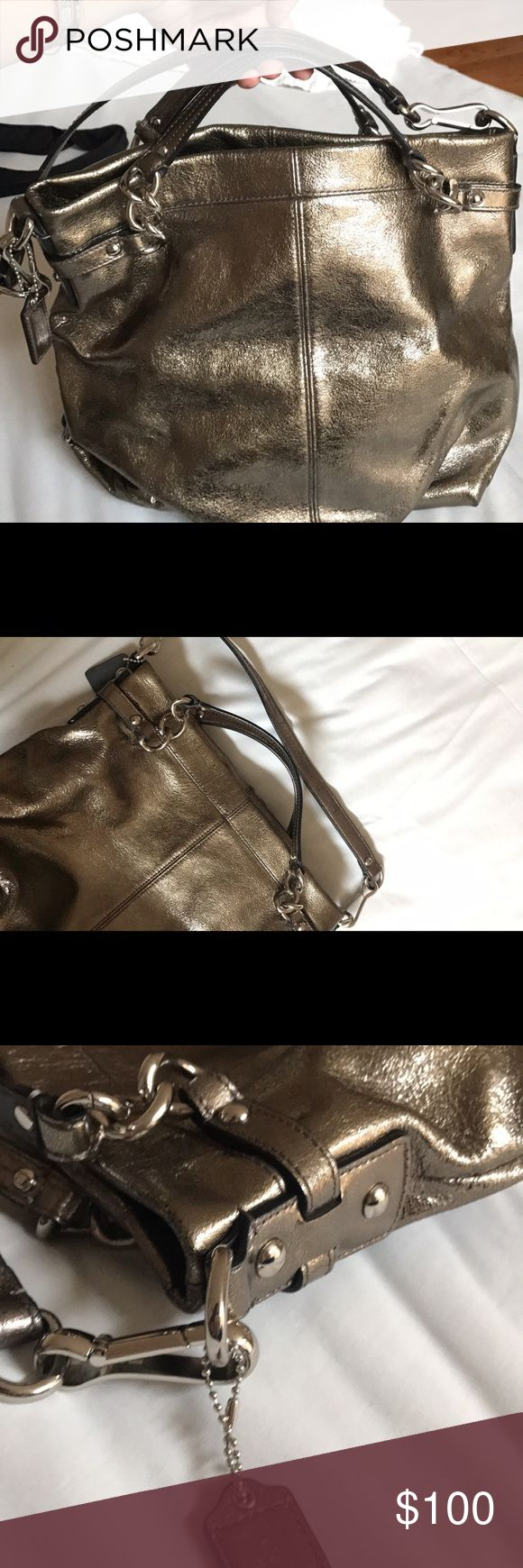 Coach Metallic Silver Shoulder Purse Coach Metallic Silver Shoulder Purse. in great condition. Preowned but very nice. Bag has zippers with Stainless Steel Accents. Coach Bags Shoulder Bags