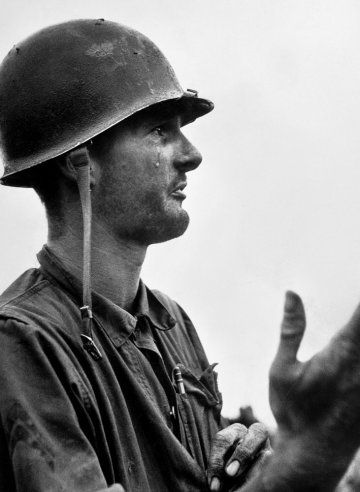 """""""Corporal Leonard Hayworth ... shows his utter frustration as he has crawled back from his position only to learn that the ammo is gone. Coda: At the last moment, supplies arrived and the men were able to hold their position."""" — From David Douglas Duncan's 1951 book, This Is War!"""
