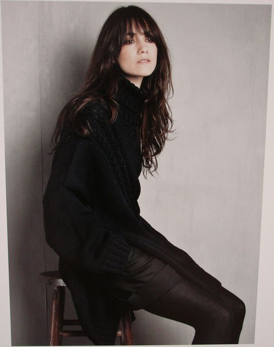 Charlotte Gainsbourg in a dark navy blue turtleneck sweater + black tailored shorts + black opaque tights