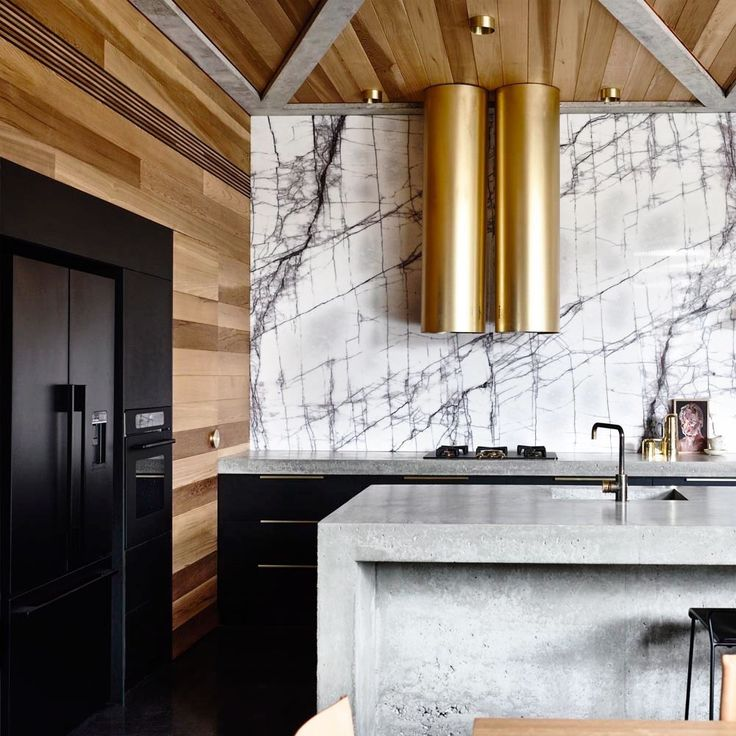 Tour a Minimalist Marble and Concrete Home With Gold Accents via @MyDomaine | @brynneparry