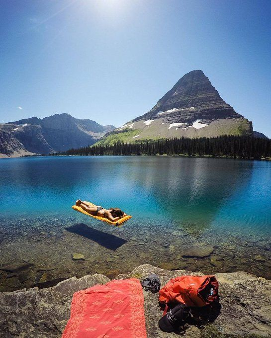Lounging in crystal clear waters at Hidden Lake, Montana. Photo by Travis Burke