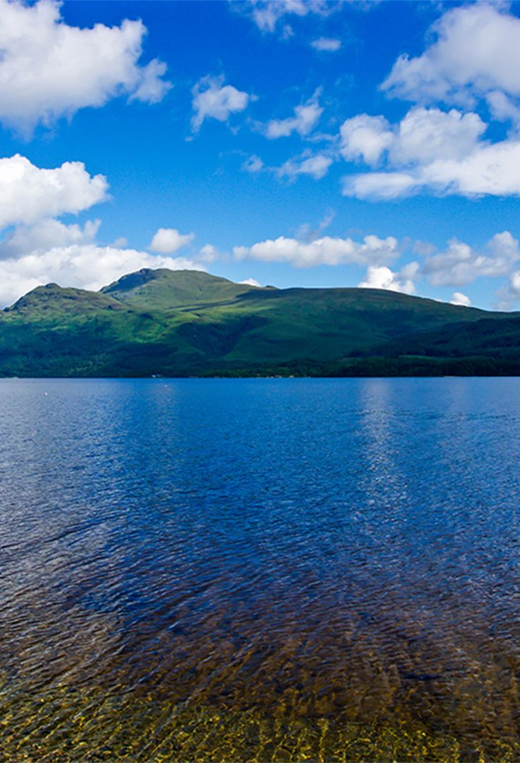 Thinking Loch Ness? Consider Loch Lomond instead. Roughly 1.5 hours from #Oban, this freshwater lake is the largest in the UK. Flanked by the Munros Mountains that seemingly dive directly into crystal-clear depths and surrounded by the wooded glens of Tossachs National Park, this could be the most beautiful lake in #Scotland.