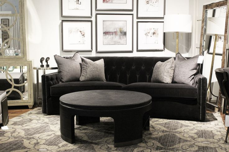 http://www.avenuedesigncanada.com Custom furniture feature with a velour tufted sofa, cowhide mirror and mirrored cabinet at Avenue Design Canada in Montreal Qc