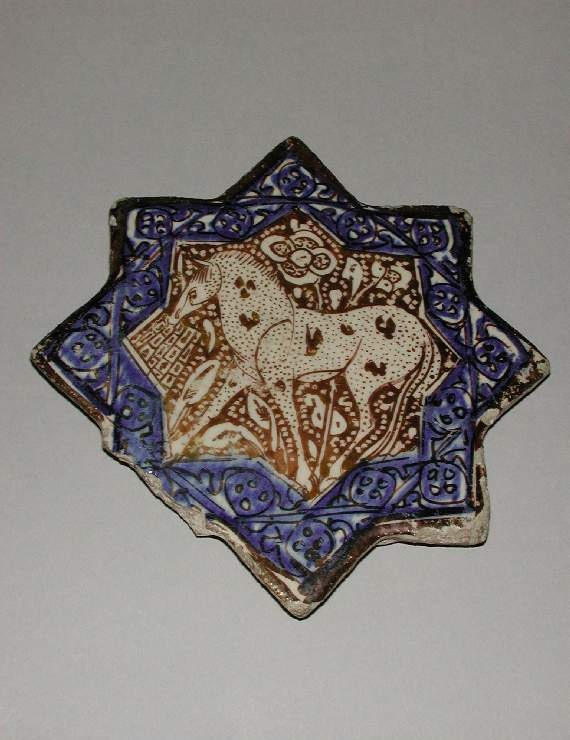 Maker:    Unknown; potter    Collection:    Friends of the Fitzwilliam Museum    Category:    fritware (stonepaste)    Name(s):    tile  Islamic pottery; category  lustre ware; category    Other Name:    eight-pointed star tile    Date:    circa 1350 — circa 1400    School/Style:    Il-Khanid    Period:    late 13th Century